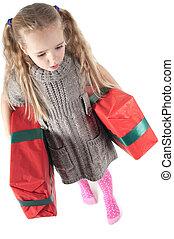 Beautiful girl walking with christmas presents