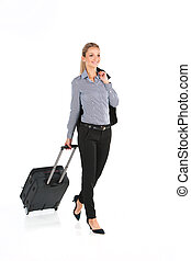beautiful girl walking with luggage and smiling. young girl...