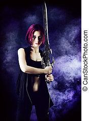 warrior - Beautiful girl warrior with a sword standing in...