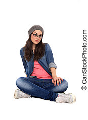 beautiful girl wearing a grey cap seating on the floor