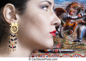 beautiful girl wearing unique handmade earrings