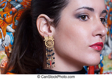 beautiful girl wearing unique handmade sicilian earrings