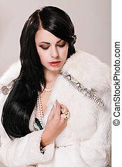 Beautiful girl white fur coat