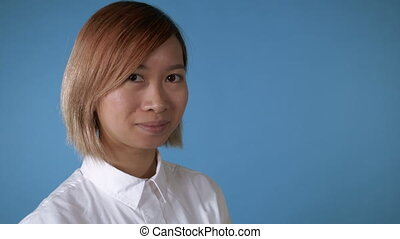beautiful girl wink - portrait young asian female posing...