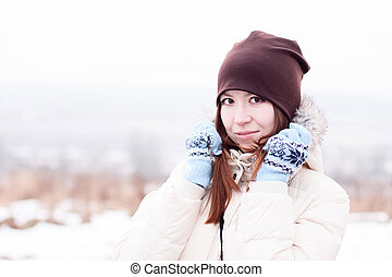 Beautiful girl winter hat outdoors smiling happy joyful, ...