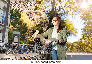 Beautiful girl with a bike in Paris