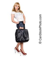 Beautiful girl with a black handbag. Isolated