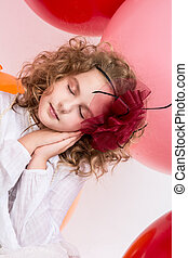 Beautiful girl with a bow on her head with eyes closed