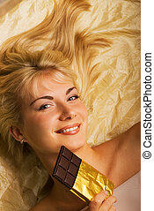 Beautiful girl with a chocolate craving close-up portrait