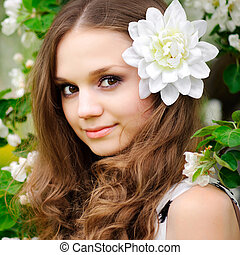 beautiful girl with a flower in her hair