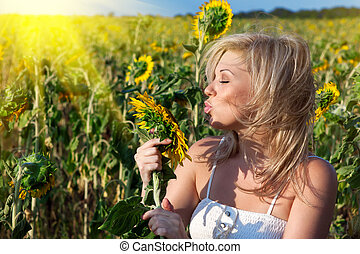 girl with a flower in the sunflower