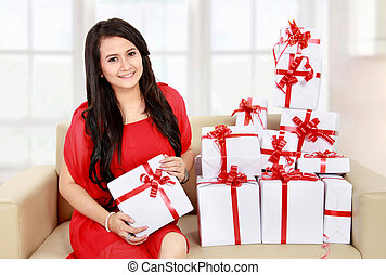 beautiful girl with a gift boxes