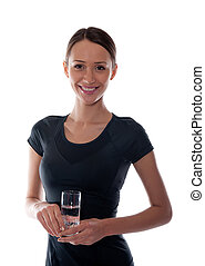 beautiful girl with a glass of water in the hands