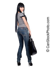 Beautiful girl with a handbag. Isolated on white