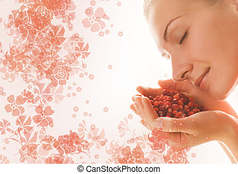 Beautiful girl with a handful of aromatic berries