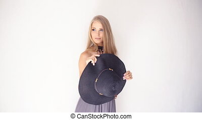 beautiful girl with a hat with a brim smiles flirts 1