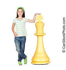 Beautiful girl with a huge piece of chess isolated on white...