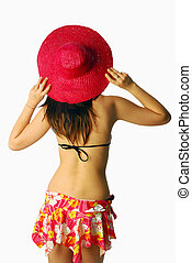 Beautiful girl with a red straw hat
