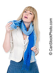 Beautiful girl with a scarf looks aside