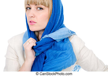 Beautiful girl with a scarf looks directly