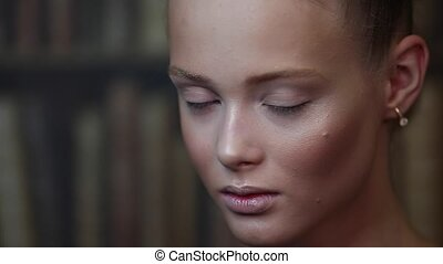 Beautiful girl with a stylist doing makeup in a beauty salon