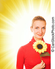 Beautiful girl with a sunflower on abstract background