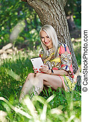 Beautiful girl with a Tablet PC