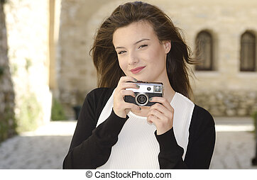 Beautiful girl with a vintage camera