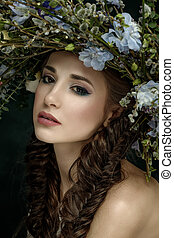 Beautiful girl with a wreath on his head. Forest Fairy.