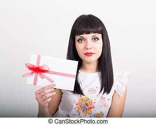 beautiful girl with an envelope tied with a ribbon