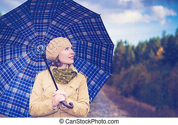 Beautiful girl with an umbrella.