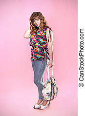 beautiful girl with bag is in style of pinup, over pink