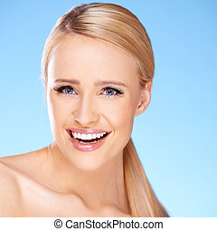 Beautiful girl with big smile on blue