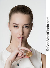 Beautiful girl with bitcoin in hand