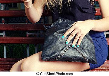 Beautiful girl with black handbag