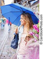 Beautiful girl with blue umbrella outdoors
