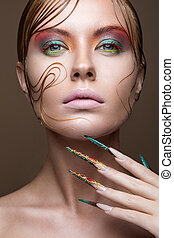 Beautiful girl with bright fashion make-up, creative hairstyle, long nails. Design manicure. Beauty face.
