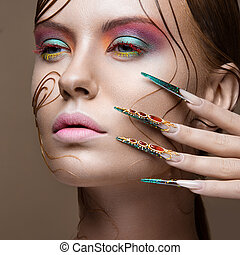 Beautiful girl with bright fashion make-up, creative...
