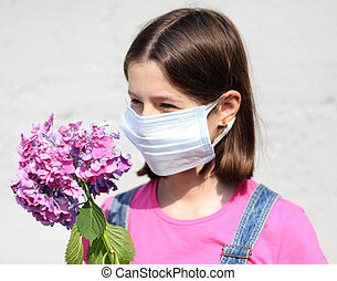 beautiful girl with brown hair and surgical mask with a hydrangea flower