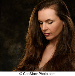 Beautiful girl with brown long hair