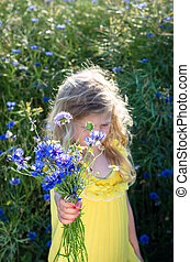beautiful girl with bunch of flowers