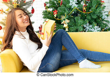 beautiful girl with christmas present gift box