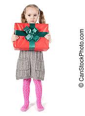 Beautiful girl with christmas present