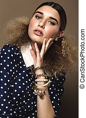 Beautiful girl with classic make-up and hairstyle art, clothing retro style. Beauty face