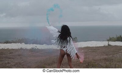 Beautiful girl with colored smoke