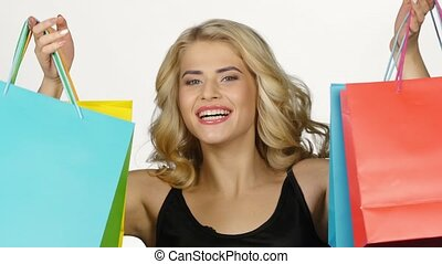 Beautiful girl with colorful packages. Shopping. White