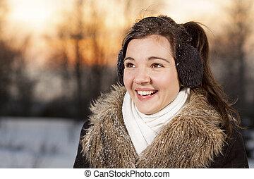 Beautiful girl with ear muffs