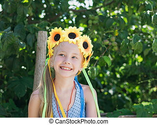 Beautiful girl with floral decoration fun glances to the side.