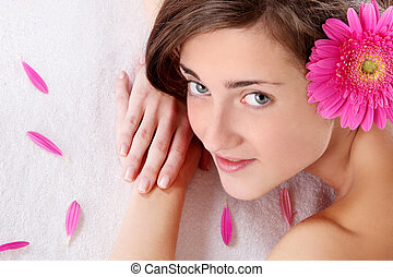 Beautiful girl with flower in hairs