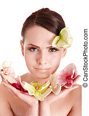 Beautiful girl with  flower in spa.